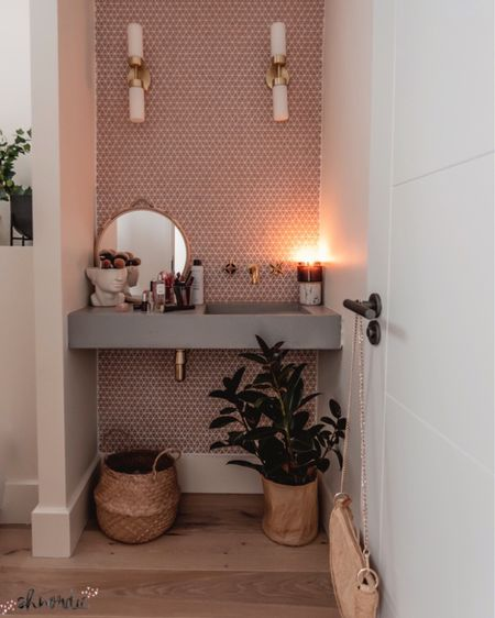 My favourite bathroom currently! It's compact but pretty, love the gold taps and concrete sink, combined with seagrass baskets, bamboo mirror and all my favourite beauty products: the shiseido serum has been saving my dry skin lately.  Follow me at @shnordic for more style, beauty & decor finds ❤️  http://liketk.it/2VRwJ #liketkit @liketoknow.it #LTKhome #StayHomeWithLTK #LTKbeauty @liketoknow.it.europe @liketoknow.it.home      #bathroomdesign #bathrooms #bathroom #sink #bathroomdecor #bathroomgoals #neutrals #smallspaceliving #plantsmakemehappy #concretesink #pinktiles #bathroomstyling #cloakroom #bathroominspo #myinteriorstyle #myinterior #homeandliving #mynordicroom #rusticdecor #stylingmynest #stylingmyhome #interieur #scandinavianinterior #scandinavianstyle #bathrooms #vanity #bathroomvanity #powderroom
