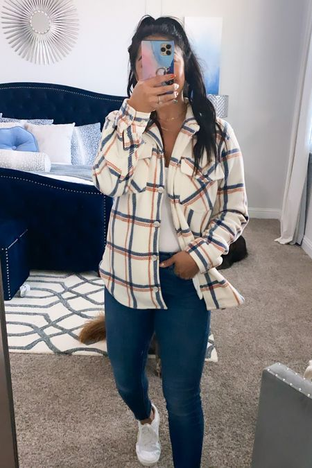 Wearing a small in this plaid button up from thread and supply