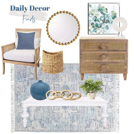 Shop my daily decor finds!    http://liketk.it/3jEBr #liketkit @liketoknow.it @liketoknow.it.home #LTKhome #LTKsalealert #LTKunder100 white coffee table, cane chair, blue throw pillow, beaded mirror, blue vase, gold links, blue rug, floral artwork, wood nightstand