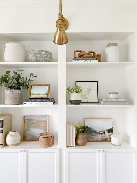 Open shelving decor ideas!  I'm loving the new fabric covered books & vase!  Faux greenery, home decor books, vases & more.   You can instantly shop my looks by following me on the LIKEtoKNOW.it shopping app http://liketk.it/3hgOe #liketkit @liketoknow.it @liketoknow.it.home   #LTKunder50 #LTKunder100 #LTKhome