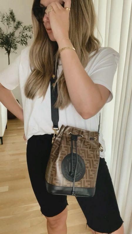 White padded shoulder t-shirt and long denim shorts 🖤 fendi bag, strap sandals http://liketk.it/3k0wo #liketkit @liketoknow.it