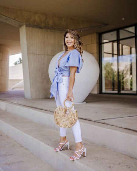 This baby blue top has a wraparound styling with tie closure and is just darling!  The flutter sleeves is absolutely dreamy! http://liketk.it/2T7bk @liketoknow.it #liketkit #LTKstyletip #LTKunder100 #LTKitbag #LTKshoecrush Download the LIKEtoKNOW.it app to shop this pic via screenshot