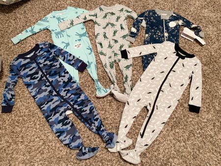 We found the BEST sleepers for Greysyn a few weeks back and I am loving them😍 the camo and lightning strike one are a bit of a splurge, but sooo good🙌🏼 They are by Tucker and Tate from Nordstrom and they are flexible, comfortable material, and not too thick so they won't get hot!💙The other three are more budget friendly and they're the burts bees and caters for you brand from Target😍 We got his sleepers in 12-18 months and they fit perfectly!   • I've linked them all here for you, so happy shopping🙌🏼  #LTKunder50 #LTKunder100  #StayHomeWithLTK #LTKkids #LTKbaby