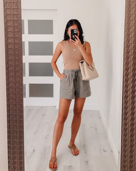 How to style khaki olive green shorts, I love this ribbed knit tank it's super comfortable and soft  Ribbed knit tank wearing size Small Shorts wearing size Medium Sandals Went up a half size wearing 7.5  #LTKshoecrush #LTKstyletip #LTKSeasonal