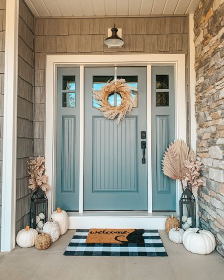 Bohemian farmhouse fall porch 🍂🌾 All details are live on hellotravelblog.com! What do you think of this year's fall decor?   Everything is also linked in the @shop.ltk app here #liketkit #frontporchdecor #falldecor #pumpkinseason #modernfarmhouse #frontporch #fallporch #hellotravelblog #fallwreath   #LTKhome #LTKSeasonal