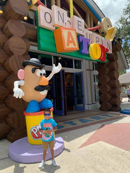 Toy Shopping at Disney Springs. Having a blast 💥 Minecraft shirt. #Toys #Kiddos #Shirts #Minecraft #SummerVibes   #LTKkids #LTKfamily #LTKtravel