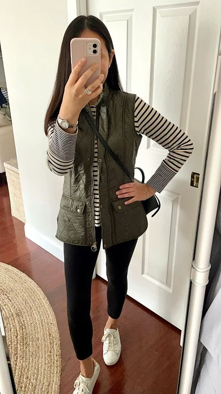 I took this Fleece lined Barbour vest in US 6 / UK10. It's a slim fit and I tried US 4 / UK 8 before but it was snug when fully zipped so I sized up yet again so that I can layer comfortably underneath.  The waist has button tabs so that you can button it for a figure flattering fit.   I took the striped tee in size XS and the leggings in girl's size 13.  #LTKunder100 #LTKSeasonal #LTKGiftGuide