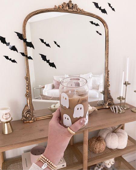 SpOoky season things 👻🤍   Etsy, ghost cup, gold jewelry, console table, living room, primrose Anthropologie mirror, Halloween decor   #LTKunder50 #LTKSeasonal #LTKunder100