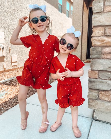 An old picture of the girls that I love, I linked similar options to their red polk-a-dot romper! These are perfect for fall with a denim jacket! Linked the girls bows and their jelly sandals. #competition   #LTKSeasonal #LTKkids #LTKbacktoschool