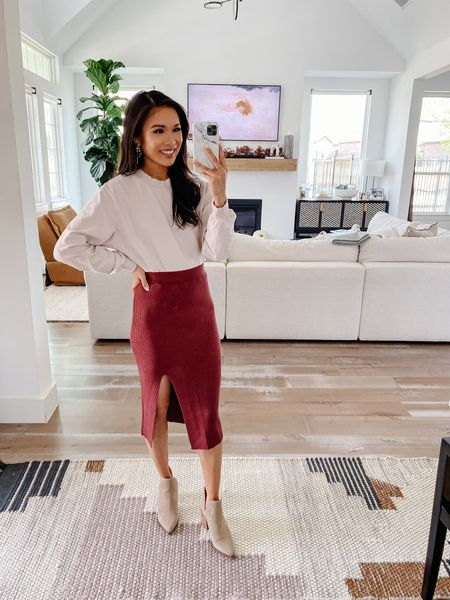 Obsessed with this ribbed slit midi skirt! Part of the LTK sale at Abercrombie. Wearing a size XS and this fits true to size. Also linking my favorite booties and a similar crewneck to what I'm wearing.    #LTKSale #LTKunder100 #LTKstyletip