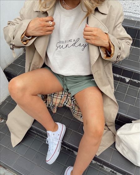 Styling a burberry trench coat with some another version sweat shorts and an oversized sweatshirt - teamed with low rise white converse   #LTKunder100 #LTKSeasonal #LTKeurope
