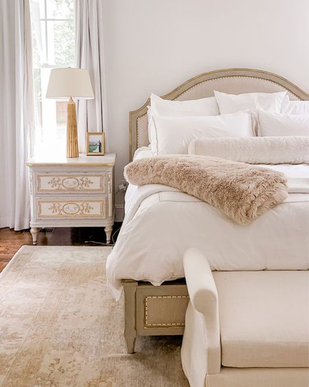 Our primary bedroom details. Bed is Kathy Kuo, nightstands are Eloquence, and bench is custom. Linked exacts where possible and similar otherwise.  #bedroom #masterbedroom #fauxfurblanket #fauxfurthrow