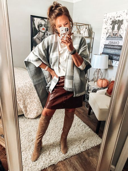 Faux leather skirt comes in 2 more colors, has stretch in it and runs a little big. Styled with taupe tall boots and a plaid poncho from Pink Lily Boutique   Fall outfits, workwear, date night, leather skirt, qvc fashion     #LTKsalealert #LTKunder50 #LTKstyletip