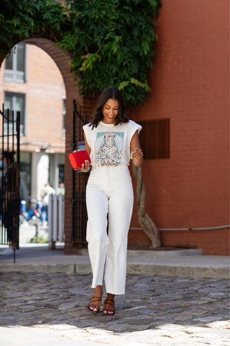 Graphic T-shirt, white jeans, sandals, summer outfits  http://liketk.it/3iSJB #liketkit @liketoknow.it #LTKunder50 #LTKstyletip #LTKunder100