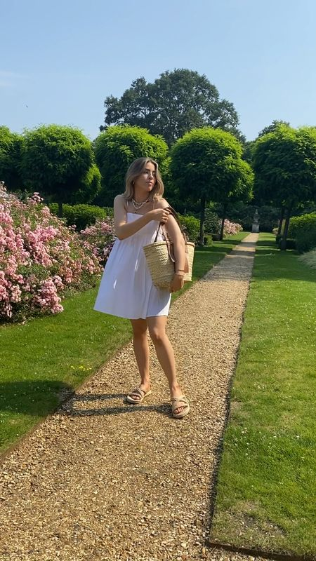 One little white summer dress styled from day to night   I love this dress teamed with a basket bag and sandals for an easy day look and then teamed with a pair of green heels for more of an evening vibe     #LTKeurope