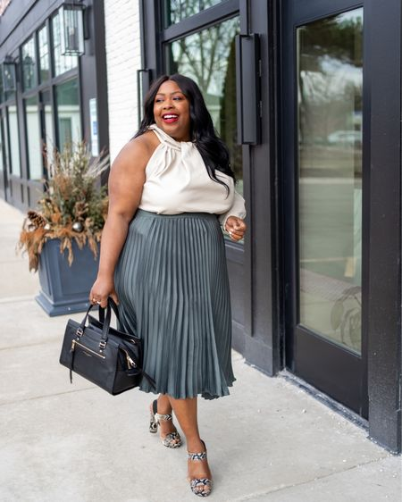 Statement tops are one of the hottest spring trends.   Paired with a pleated skirt and snake print sandals this is a perfect play on neutrals.   #LTKshoecrush #LTKstyletip #LTKcurves