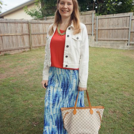 Red and blue again ❤💙 Added the white denim jacket to this outfit as it was cooler than expected that morning for the school run. Went without my jacket in the afternoon when it warmed up though and to make it easier for getting my flu shot. The kids had to get theirs too so that was a very stressful appointment 😅 Apparently the receptionists have seen and heard worse reactions to kids getting their vaccines but they may have just been saying that to make me feel better 🤣  Louis Vuitton Neverfull for water bottles, post flu shot treats and some bribery chocolate 😅 I like the way the bag matches the tie dye maxi skirt with the blue and white and the red tee is a fun pop of colour ❤  -------------------- -------------------- ---------------- ----------------  Screenshot this pic to shop the product details from the @liketoknow.it app, or click here: http://liketk.it/3guSl #liketkit #LTKitbag #louisVuitton #lvneverfull #neverfullMM #everythingLooksBetterWithABag #wearedonthestreet #everydaystyle #realeverydaystylepic #realmumstyle