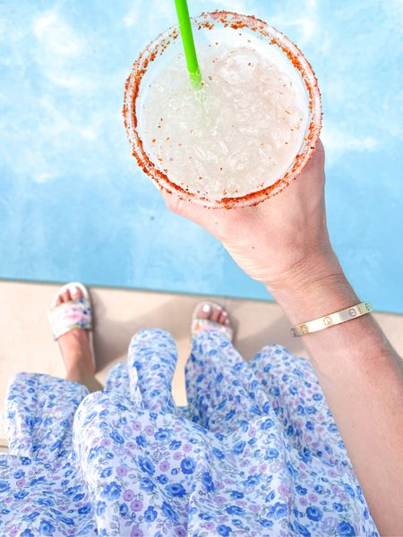 What's your favorite? A spicy marg or regular…?! #ootd #fashion #summer #poolside #loveshackfancy #floralskirt #gucci #guccislides #spicymarg #cocktail #cheers   #LTKshoecrush #LTKsalealert #LTKswim