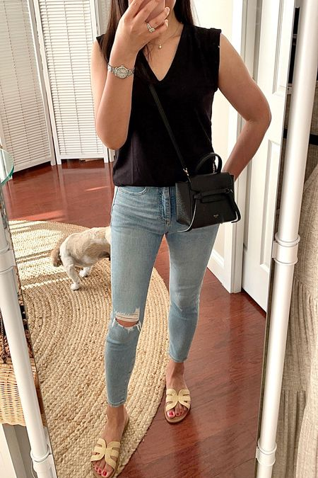 I sized down in the tee (XXSP) since it's a looser fit. The distressed jeans I sized up one size to 26/2 petite.   #LTKunder100 #LTKshoecrush #LTKstyletip