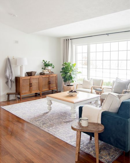 Cane cabinet look alikes coming at you! My wood cabinets are the number one asked about item in my living room and they are always so out. But I found a few that are almost identical in stock right now from other stores! Plus my favorite curtains and arm chairs are linked! @liketoknow.it #liketkit http://liketk.it/37Rm2 @liketoknow.it.home #LTKhome #LTKunder100 #LTKunder50