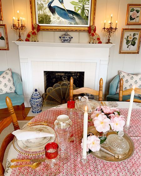Here's a look at my festive Valentine's Day table for two almost completely set with family heirlooms.  I just love using my mama and grandmama's beauties to set a pretty table.  I'll give you all the details, but first this! tablecloth! It is by Lovely Lady Linens and it's a beautiful Indian block print in pink and green.  It would be lovely at Christmas, but it is just right for Valentine's Day! I'm *in love* with it!  The centerpiece of my beloved camellias in an old King's Crown Ruby Candy dish and a silver tussie-mussie (or nosegay) sit on an old silver tray that I won in a pageant ages ago (yep!).  The place setting includes my maternal grandmother's wedding china Haviland Apple Blossom and white napkins along with my mother's gold plated silver, her gold-rimmed water glasses, her King's Crown Ruby Thumbprint Goblets and salt cellars.  The napkin rings are vintage glass ones I found on eBay, and the chargers are from Tablecloths Factory.  Happy Valentine's Day, loves! I hope you spend it with the one's nearest and dearest to your heart.  http://liketk.it/38hwF #liketkit @liketoknow.it #LTKSeasonal @liketoknow.it.home Shop your screenshot of this pic with the LIKEtoKNOW.it shopping app