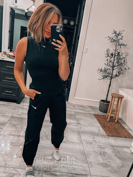 XS in top and joggers. Nike. Just do it