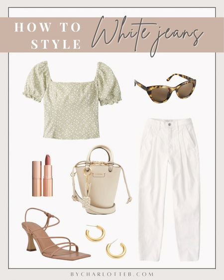 How to style white Abercrombie 80s high rise mom jeans (run TTS): green floral square neck puff sleeve top, see by Chloe white bucket bag, marc fisher dami strappy sandal, gold hoop earnings, and cat eye tortoise sunglasses