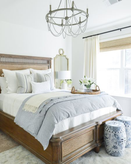 This blue and white guest bedroom will always be one of my favorites!  http://liketk.it/3cRSt #liketkit @liketoknow.it #LTKhome #LTKstyletip home decor bedroom decor mirror pair earthy lamp beaded chandelier garden stool duvet cover bedding