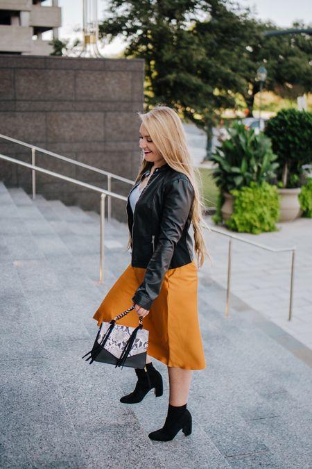 Express vegan leather moto jacket with orange midi skirt and white downtown cami paired with snake print handbag and black sock booties from DSW  Photo by https://www.celestemckinley.com   http://liketk.it/2GnHJ #liketkit @liketoknow.it #LTKshoecrush #LTKitbag #LTKsalealert