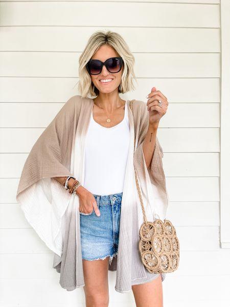 Love throwing a kimono over a bodysuit and denim shorts for a casual summer look!   #LTKsalealert #LTKstyletip #LTKunder100