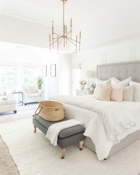 Master bedroom styled for spring with pops of pink  http://liketk.it/3cLKM #liketkit @liketoknow.it #LTKhome #LTKstyletip home decor bedroom decor spring decor white bedding platform bed glass lamp woven rug Moses basket master bedroom suite