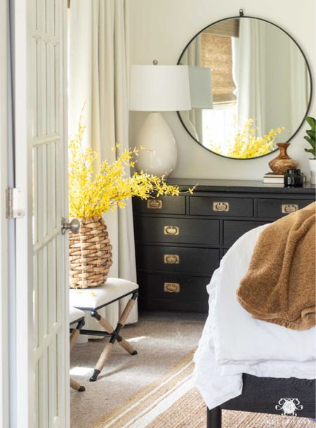 Our downstairs guest bedroom is ready for visitors! Home decor bedroom decor round mirror teddy bear throw x bench white bedding jute rug  #LTKhome #LTKfamily #LTKstyletip