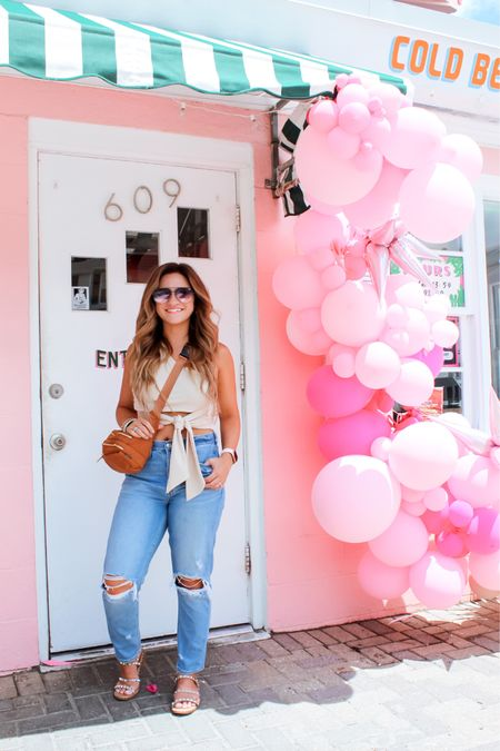 """One shoulder tie top from SHEIN - use code """"AnnaQ415"""" for 15% off. #sheingals   Distressed mom jeans  Sam Edelman travel sandals   Quay high key sunglasses  Jewelry   Linked on @liketoknow.it   http://liketk.it/3hDmf #liketkit #LTKtravel #LTKshoecrush #LTKunder100   American eagle  Target"""