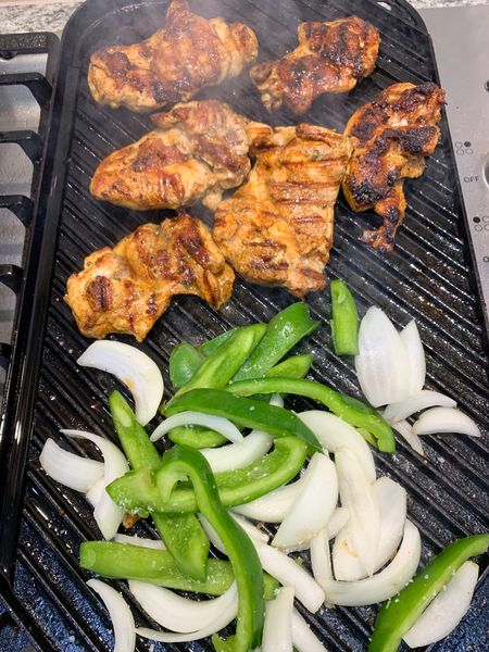 Taco Night done right. Grilled chicken fajita tacos prepared on my Cast Iron 2 in 1 Reversible Griddle. #Griddle #Homecook #StovetopGrill #Home #KitchenAccessories   #LTKhome #LTKfamily #LTKunder100