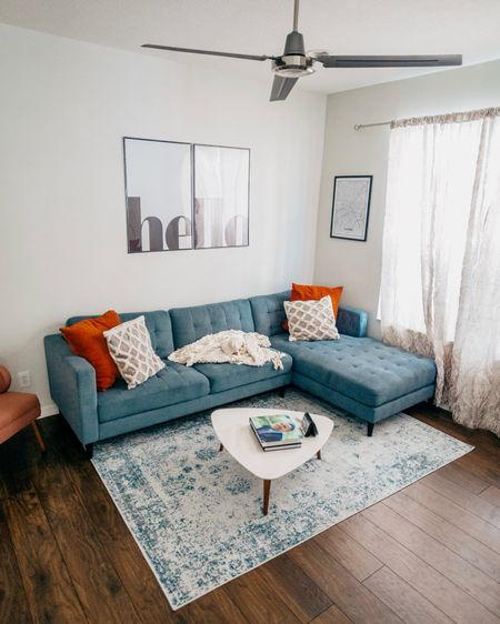 I haven't done a house tour blog post because I AM A PERFECTIONIST, but I'm trying to share more home content. One of my favorite parts of home ownership is making this place feel like it's uniquely ours. 🥰 ⠀ I was so nervous about our new blue couch, but I really think it's the perfect addition to the space! Swipe to see what our living room looked like last year around this time + what it looked like when we moved in. 🏡 ⠀ I need your help: What home content do you want to see from me? http://liketk.it/2FW6P #liketkit @liketoknow.it #LTKhome