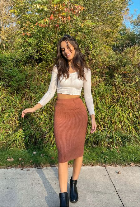 Fall outfit rust colored midi skirt black chunky boots white long sleeve crop top neutral fall fashion   #LTKfit #LTKSeasonal #LTKunder50