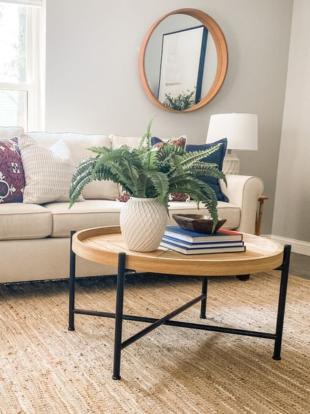 Love this modern farmhouse coffee table with a wood surface and metal base.  Living room decor, coffee table style, modern farmhouse decor, wood coffee table  #LTKhome