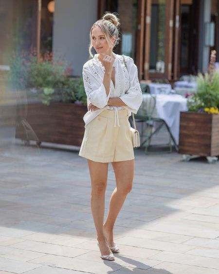 I'm 5'5 and I'm wearing a U.K. size 6 in the white lace blouse and a size 4 in the yellow shorts.  My bag is the white chevron caviar Chanel wallet on chain with light gold details ❤️  #LTKeurope #LTKstyletip #LTKSeasonal