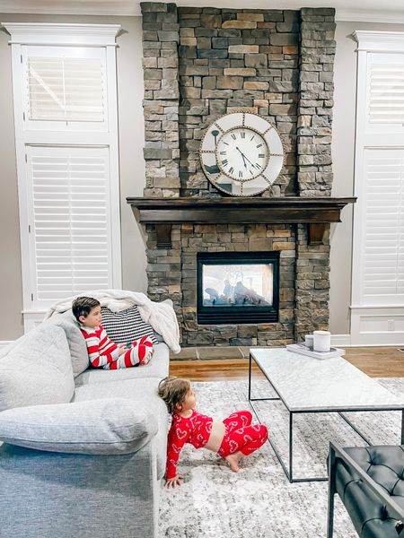 Christmas decor is down but kids are still in Christmas pajamas! Nice to have our living room back to normal! Modern living room, family pajamas, lazy one, Amazon fashion, kids pajamas, marble coffee table, family room, fireplace, grey couch, pottery barn, article furniture   #LTKhome #StayHomeWithLTK #LTKkids