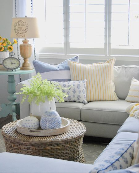 I Love to do a REFRESH of my space every Spring!!! After a long winter, by just adding brighter pops of colors in the home, it can make such a huge difference.This year, I decided to use yellow to compliment the consistent blues I love to use. Sun Shine Yellow is such a bright and happy color and super on trend this season!Switching out pillows each season is a fun and simple thing, and it makes a huge impact :) I have loved our neutral sectional over the years, plus our grey scroll Pottery Barn rug! I added a darling Rattan round coffee table and it has been amazing! So easy to live around and very heavy duty! Having a neutral backdrop of furniture and rugs to work with, make it VERY easy to change from season to season, and everything Looks Great!   * Use the @liketoknow.it app to shop this post! A simple like and screen shot will give you all the details!   #liketkit http://liketk.it/2BNp0 @liketoknow.it.family @liketoknow.it.home #LTKhome Shop your screenshot of this pic with the LIKEtoKNOW.it app