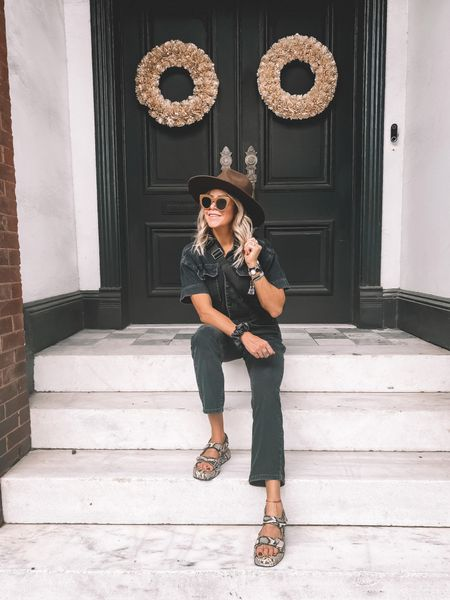 All the fall feels in this shot. Style your chic denim jumpsuit with dad sandals and a wide brimmed hat to transition perfectly to fall.   #LTKstyletip #LTKSeasonal #LTKunder100