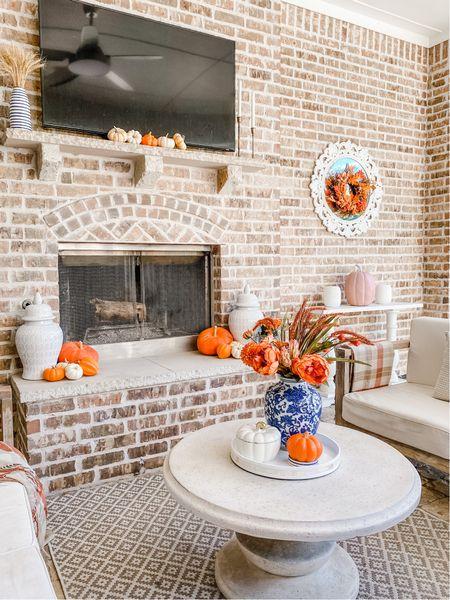 Fall patio with blue, white and pops of Orange.     #LTKSeasonal #LTKstyletip #LTKunder50