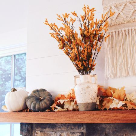 Fall decorating inspo ready! Keep it simple with a few key fall decor ideas such as using faux pumpkins, a rustic vase, a textural wall hanging, and then an impact accent such as this faux leaf garland!   #LTKFall #LTKhome #StayHomeWithLTK