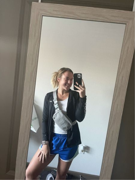 This outfit is so cute and comfy with a cross of all brands. I have the comfiest under armor jacket, Nike tempo shorts, lululemon Fanny pack, Apple Watch and of course Birkenstocks!  #LTKfit #LTKunder50 #LTKstyletip