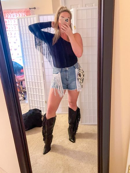 Planning a trip to NASHVILLE so shopping for   Fringe cowgirl boots, fringe belts, fringe  bags, high waisted flare jeans, fringe bodysuits and fringe  jackets!  Basically anything with fringe .  Nashville fashion Outfits for Nashville Outfits for concert Concert outfits   *sizing info: Size down in jacket… I am wearing a medium. Boots run TTS Bodysuit fits so well.. tall girl status approved. I got a large in bodysuit and skirt. If you are under 5 ft 4, you can go with your smaller size if you are in between. I got the large and am happy with the size because I am just under 5 ft 10. I got a size large in the shorts. The waist and thigh area has stretch to it. Very comfortable.  P.S. my dog is not for sale ;)  #LTKunder50 #LTKstyletip #LTKtravel