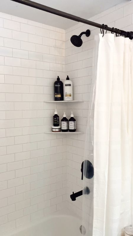 Neutral home, bathroom remodel, pretty tile, white subway tile, shower head and bath tub combo, target shower curtain, McGee and Co picture frames, design, house inspo, master bath decor, black and white,   #LTKfamily #LTKunder50 #LTKhome