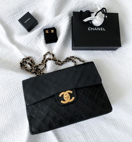 Classic bags are better investments than trendy pieces & with the right colour ways can be worn SO many ways.   Here's a vintage Chanel classic flap bag with gold CC earrings. Timeless 💗  #ChanelBag #Chanelclassicflap