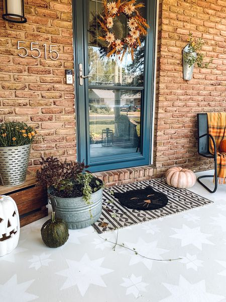 Still can't get over this porch stencil makeover!!!  Want to shop the look? I put together lots of options for rugs and planters for a gorgeous porch that will carry you all the way through fall!  #LTKhome #LTKHoliday #LTKSeasonal