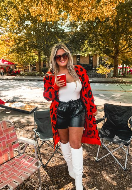 Georgia bulldogs tailgaiting outfit Dawgs red and black cardigan leather shorts white knee high cowboy boots