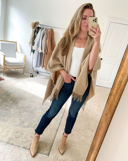 Exact fringe trim poncho is from Bloomingdales but sold out in camel. Linked a Banana option that's even more affordable and very similar! Size M in bodysuit, true size in jeans, true size in booties.  #falloutfitideas #falloutfitinspo #ruana #ponchosweater